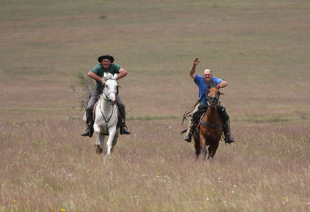Two riders racing side by side photo