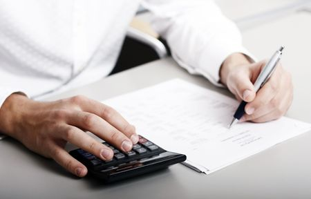 accountants: male in white shirt completing a blank form
