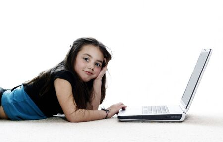 Young girl bored at the laptop photo