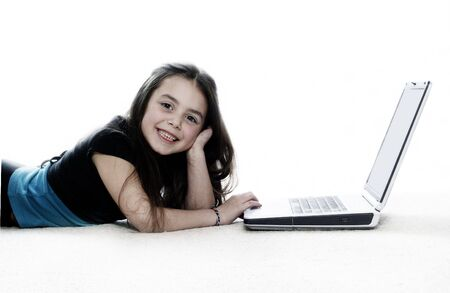 Young girl working on the laptop photo