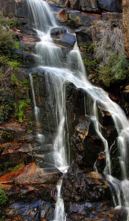 Beautiful waterfall on small forest river in the Canberra region photo