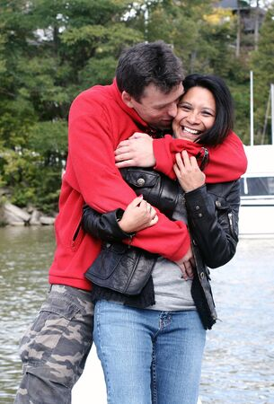 Couple having fun outdoors by the water photo