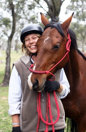 stockman: Female rider and horse in the Australian outback