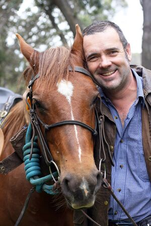 akubra: Male rider and horse in the Australian outback