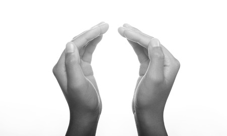 worshipping: Hands clasped in religious prayer against white background