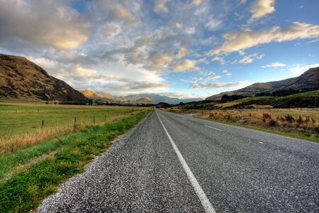 Empty road of a clear day in New Zealand photo