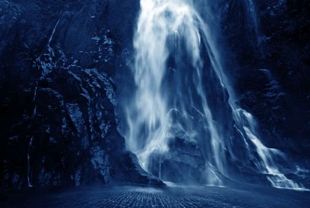 Dramatic image of a waterfall at Milford Sound photo