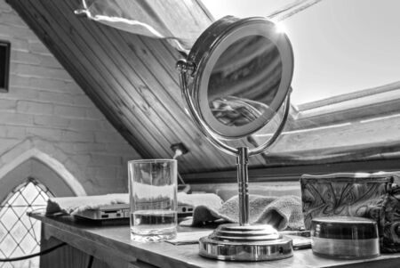 eclectic: Makeup Mirror in a Study inside an eclectic study Stock Photo