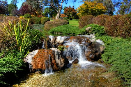 Serene Garden with greens and running water Stock Photo