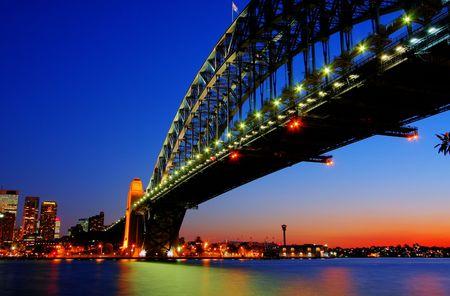 down lights: Sydney Harbour bridge in dusk lighting Stock Photo