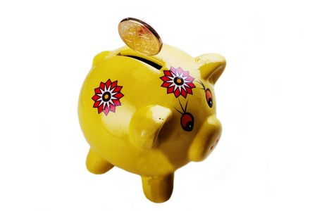 Yellow Piggy Bank against white background photo
