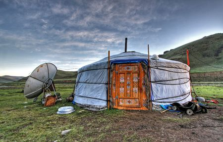Mongolian dwelling on the green plain of grass Stock Photo