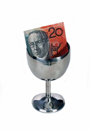 tipping: Australian twenty dollar note in a tipping cup Stock Photo