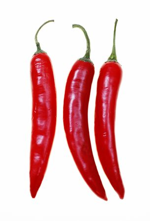 chillies:  Red hot chilli peppers isolated on white background Stock Photo