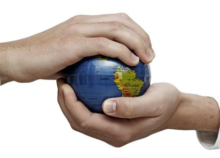 Businessman holding and examing globe, conceptual usage Stock Photo - 5022633