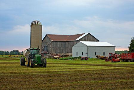 farmhouse in Onatrio against dramatic sky photo