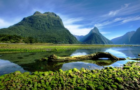 new world: Mitre Peak in New Zealand at low tide