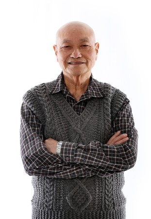 elderly asian man standing against white background photo