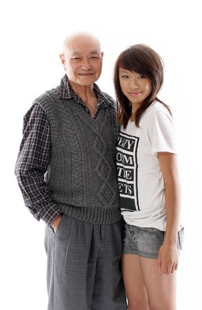 positive image of an asian grandfather with his granddaughter Stock Photo