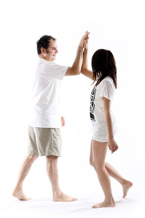 man and girl, high fiving each other against white photo