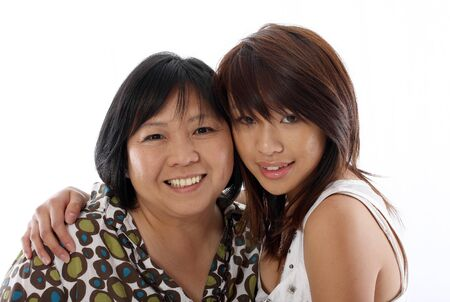 mum and daughter having fun, isolated on white background photo