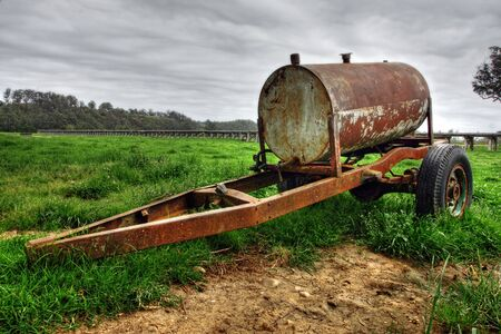 Rusty oil drum wagon on grass Stock Photo - 7173971