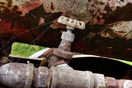 Rusty oil drum wagon on grass Stock Photo - 7173795