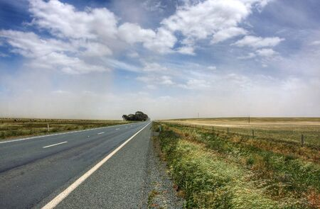 dust storm over an australian road photo