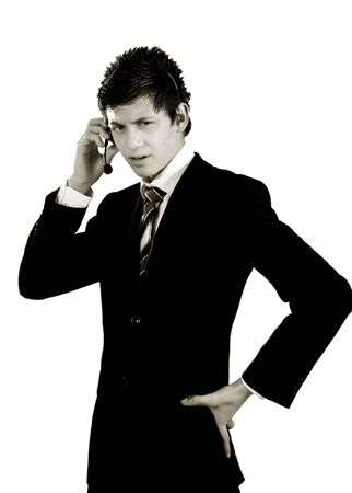confident young man in suit talking on phone photo