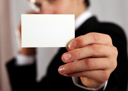 technology deal: professional man presenting blank business card