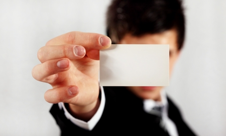 sales meeting: professional man presenting blank business card