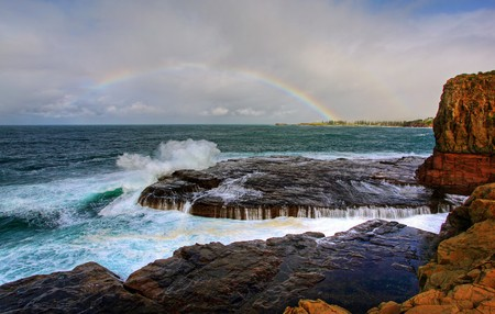 kiama: rainbow over the ocean landscape