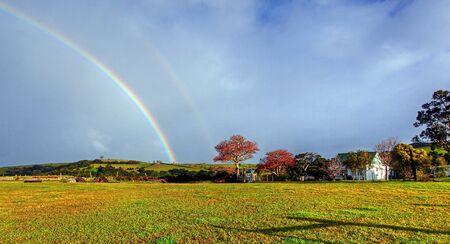 rainbow over a farm field Stock Photo - 7927564