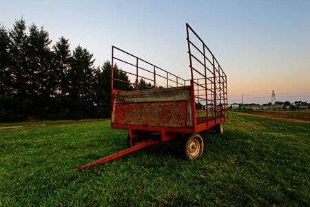 steel wagon on a grass field photo