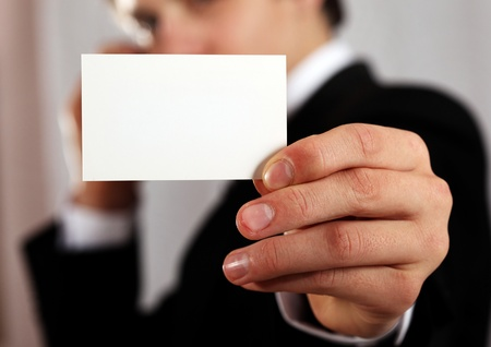 professional man presenting blank business card