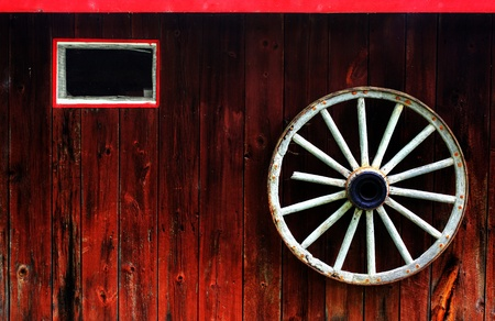 rustic wagon wheel hanging on a wall Stock Photo - 9852574