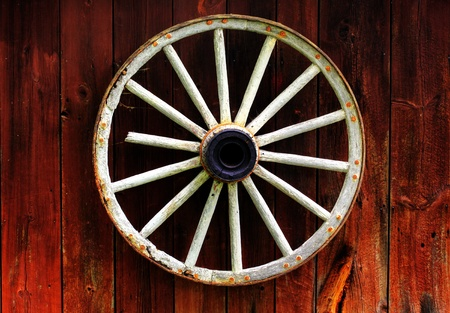 wagons: rustic wagon wheel hanging on a wall Stock Photo