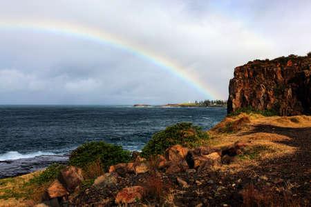 rainbow over the ocean landscape photo