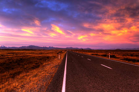 lonely country road landscape in vibrant colors Stock Photo - 9852345