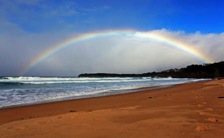 rainbow over the ocean landscape photo