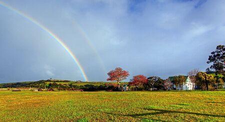 rainbow over a farm field Stock Photo - 9852649