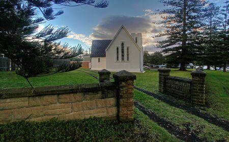 church steeple: quiet white church against green and blue