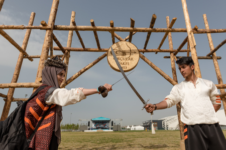Unidentified people perform a medieval fight show with swords in retro costume of ancient Turkish troops and ottoman empire soldier.ISTANBUL,TURKEY,MAY 13,2017