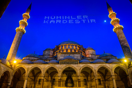 """hung: ISTANBUL, TURKEY - JUNE 4, 2017:Mahya of """"Muslims are brother"""" is written and hung between minarets of Suleymaniye Mosque. Mahya is to write with light especially during ramadan month for muslims Editorial"""