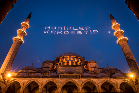 hung: ISTANBUL, TURKEY - JUNE 4, 2017:Mahya of �Muslims are brother� is written and hung between minarets of Suleymaniye Mosque. Mahya is to write with light especially during ramadan month for muslims