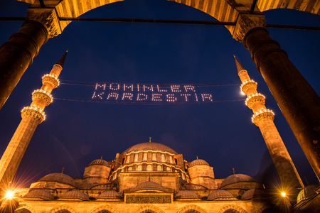 "ISTANBUL, TURKEY - JUNE 4, 2017:Mahya of ""Muslims are brother"" is written and hung between minarets of Suleymaniye Mosque. Mahya is to write with light especially during ramadan month for muslims Editorial"