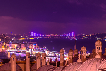 ISTANBUL, TURKEY - JUNE 4, 2017: Night view of galata tower, bosphorus,karakoy bridge and 15 June Martyrs and shore of Beyoglu district from the courtyard of Suleymaniye Istanbul, Turkey. Editorial