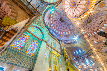 Interior decoration view and artworks of  Blue Mosque also called Sultan Ahmed Mosque or Sultan Ahmet Mosque.Ceiling and domes decorations with Islamic elements.ISTANBUL,TURKEY- MARCH 11, 2017