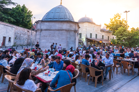 ISTANBUL, TURKEY - JUNE 4, 2017: People are eating iftar(evening meal,dinner) during Ramadan in Suleymaniye square. Suleymaniye district is the most popular place for Ramadan activities in Istanbul