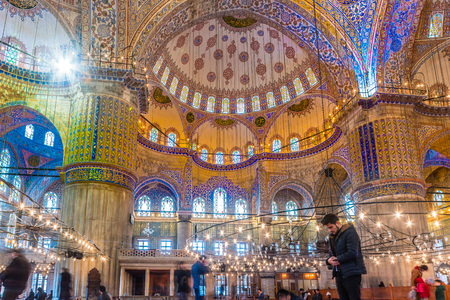 Muslim People praying in Blue Mosque also called Sultan Ahmed Mosque or Sultan Ahmet Mosque.ISTANBUL,TURKEY- MARCH 11, 2017